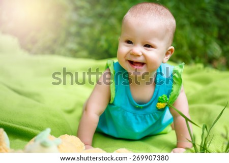 Adorable Toddler Baby Girl playing and having Fun in the Garden - stock photo