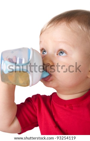 Adorable toddler boy drinking juice from baby bottle isolated