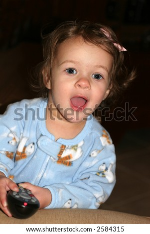 adorable toddler girl holding phone - stock photo