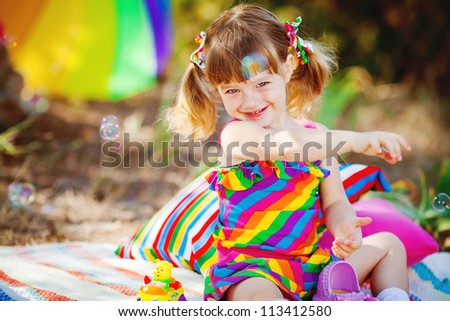 Adorable toddler girl playing outdoors in green summer park - stock photo