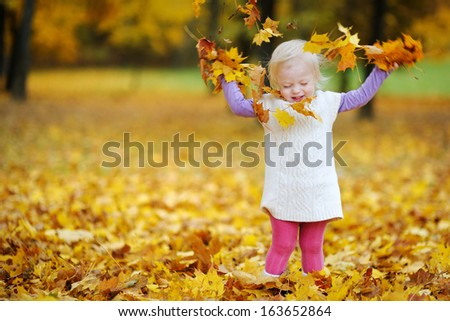 Adorable toddler girl portrait on beautiful autumn day - stock photo