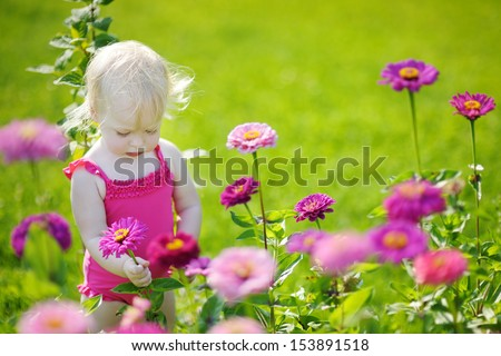 Adorable toddler girl portrait outdoors at summer - stock photo