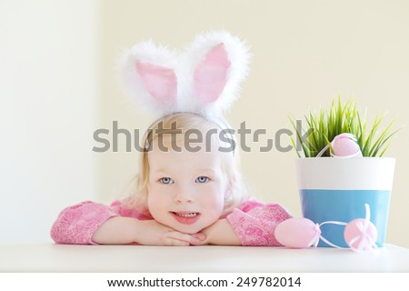 Adorable toddler girl wearing bunny ears on Easter day - stock photo