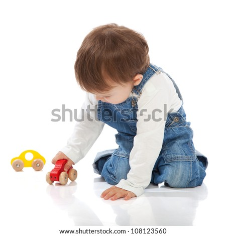 Adorable toddler playing with toy cars, isolated on white - stock photo