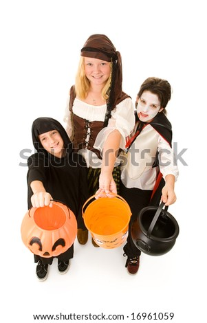 Adorable trick or treaters in halloween costumes, begging for candy.  Full body isolated on white. - stock photo