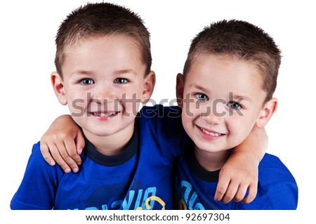 adorable twins on a white background for cutout - stock photo