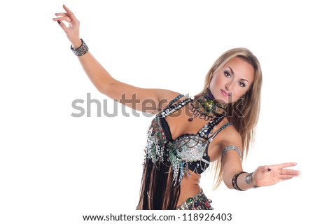 Adorable woman bellydancer dancing in traditional tribal costume. Portrait of oriental artist in ethnic wear.