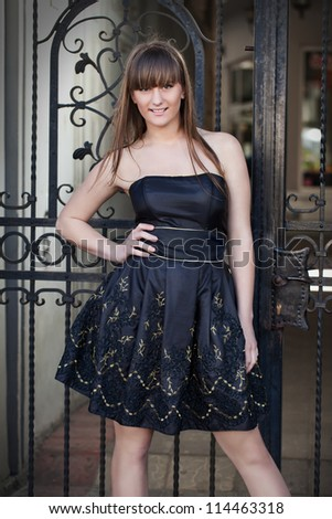 Adorable woman posing in stylish dress