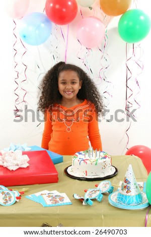 Adorable 8 year old African American girl at birthday party.