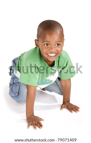 Adorable 3 year old african american or black boy on his knees smiling - stock photo