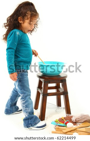 Adorable 3 year old Hispanic-African American girl, baking cookies over white background. Shocked at mess made. - stock photo