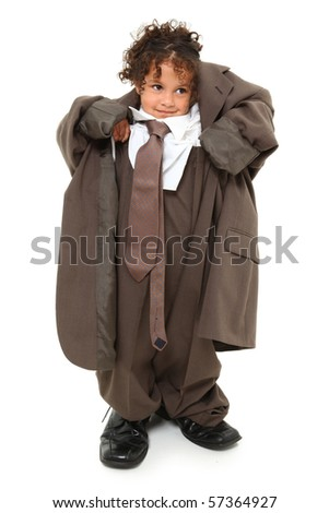 Adorable 3 year old mixed race girl in over-sized baggy suit over white background. - stock photo