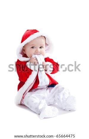 Adorable young baby girl with a cute santa suit on