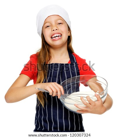 adorable young chef girl mixing flour with whisk for baking and cooking isolated - stock photo
