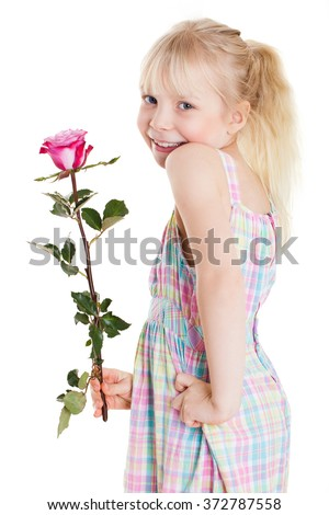 adorable young girl with a rose - stock photo