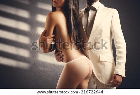 Adoration of a sexy girl by a man - stock photo
