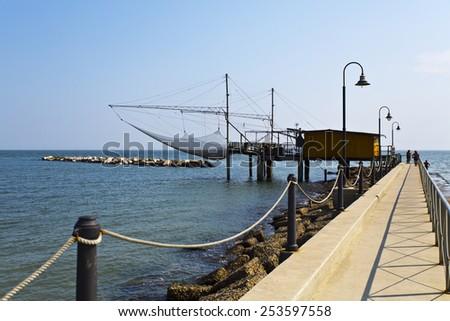 ADRIATIC SEA, ITALY - SEPTEMBER 6, 2014: Trabucco is an old fishing machine typical of the Italian Adriatic Sea coast  - stock photo