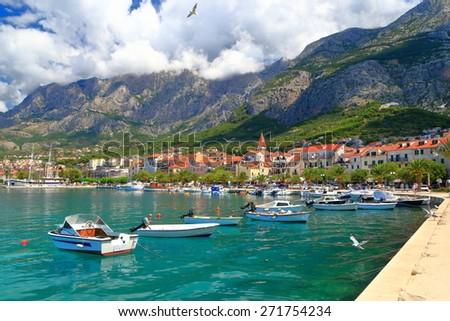 Adriatic sea shore with small leisure boats inside the harbor of Makarska, Croatia - stock photo