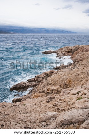 adriatic seashore with rocky coast and little raged sea, island krk, croatia