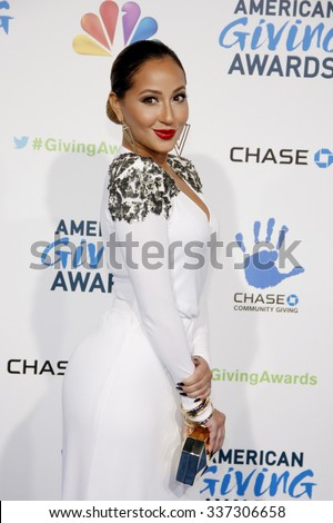 Adrienne Bailon at the 2nd Annual American Giving Awards held at the Pasadena Civic Auditorium in Los Angeles, California, United States on December 7, 2012.  - stock photo