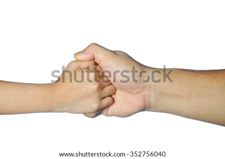 adult and kid hands hold each other fingers firmly isolated on white