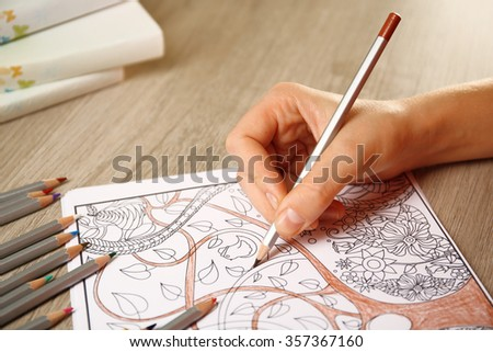 Adult antistress colouring book with pencils - stock photo