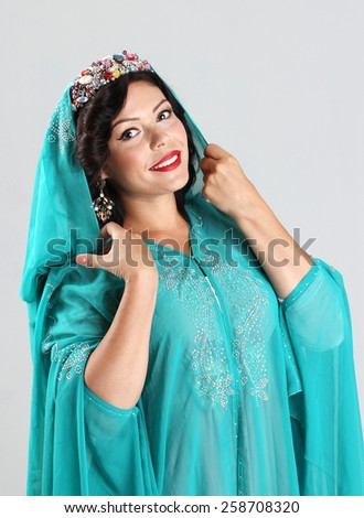 Adult arabian woman in green abaya - stock photo