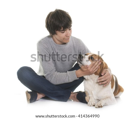 adult beagle and teenager in front of white background