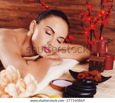 Adult beautiful woman relaxing in spa salon. Beauty treatment therapy - stock photo