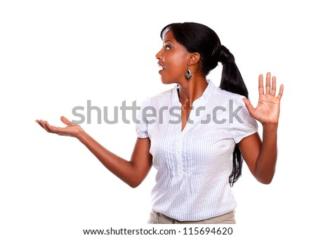 Adult black woman giving the high while is looking to her right on isolated background - stock photo