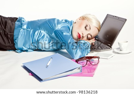 adult blonde girl asleep on the computer in the office - stock photo