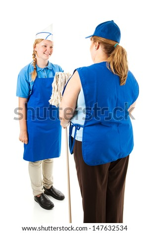 Adult boss hands a mop to a cheerful teenage worker.  Isolated on white.   - stock photo