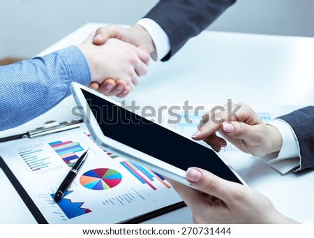 Adult. Business handshake - stock photo