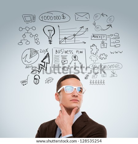 Adult business man thinking of his plans - stock photo