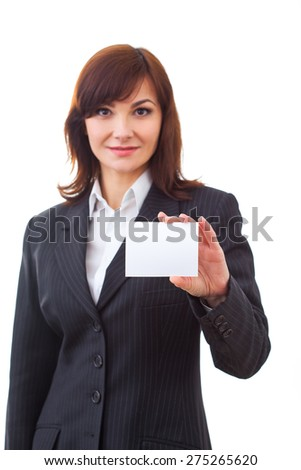 adult business woman holding showing paper card smiling happy in suit - stock photo