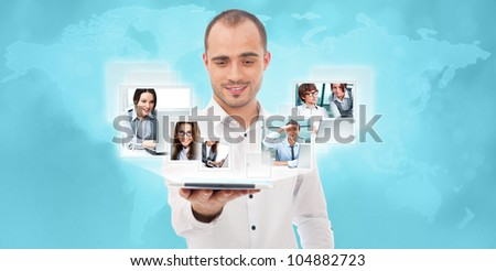 Adult businessman using his tablet computer to communicate his team. Virtual meeting technology for global business concept. World map on background