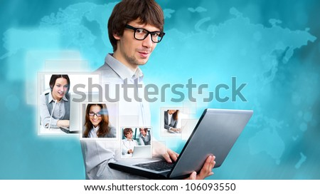 Adult businessman using his tablet computer to communicate his team. Virtual meeting technology for global business concept. - stock photo
