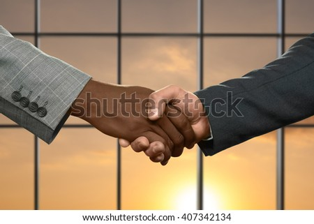 Adult businessmen shaking hands. Handshake on sunny sky background. Partnership begins from simple things. Honesty or deception. - stock photo