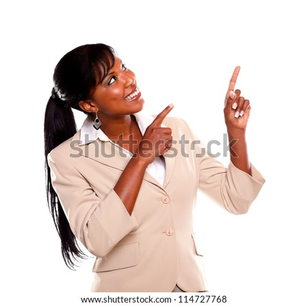 Adult businesswoman looking and pointing up on isolated background - stock photo