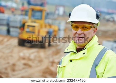 Adult construction manager or building site foreman worker - stock photo