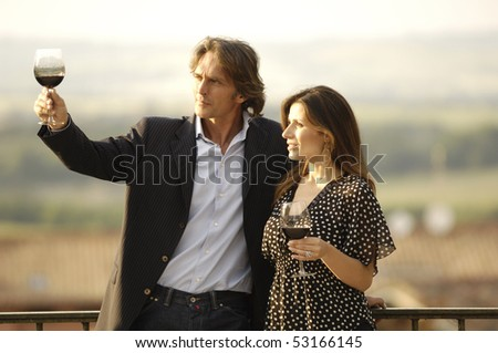 adult couple lookint at wine colour - stock photo