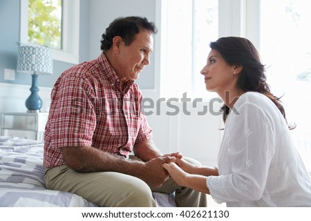 Adult Daughter Comforting Father Suffering With Dementia