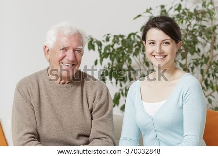 Adult daughter is spending time with her father  - stock photo