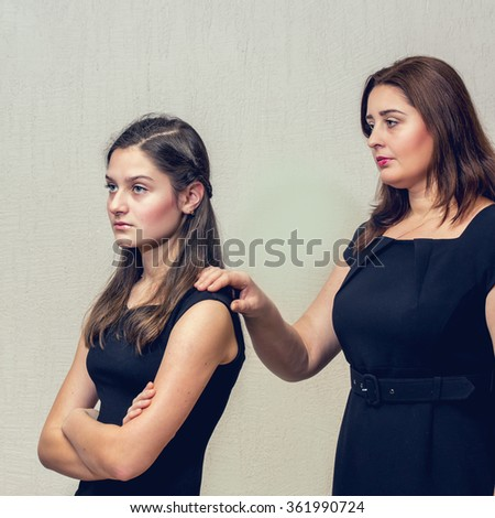 Adult daughter quarrel with her mother. Conflict of generations. - stock photo