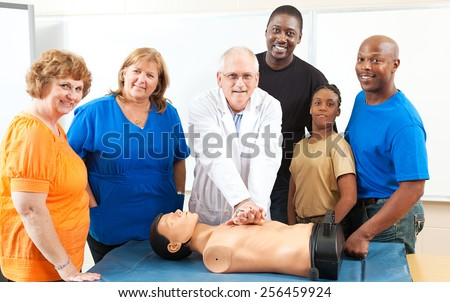 Adult education class learning CPR first aid from a doctor.