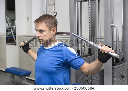 adult engaged in active sports in the gym - stock photo