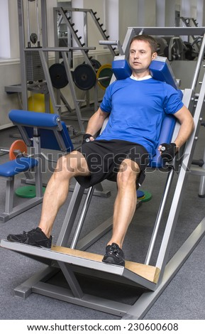 adult engaged in active sports in the gym