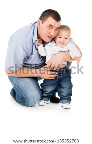 adult father hugs little son isolated on white background