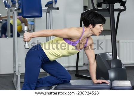 adult female bodybuilding competitions in the gym - stock photo