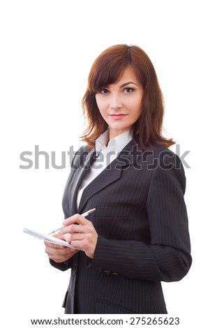 adult female in black suit makes some notes in notepad, isolated on white
